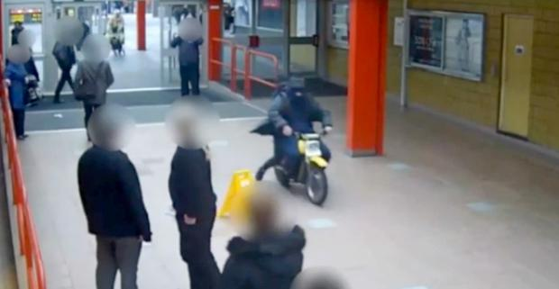 CCTV footage shows James Kinsella riding a scrambler bike through Strand complex in Bootle, Merseyside