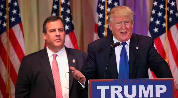 Donald Trump speaks to the media at his Mar-A-Lago Club flanked by New Jersey Governor Chris Christie (File photo by John Moore/Getty Images)