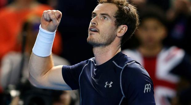 Winning start: Andy Murray fist pumps after beating Taro Daniel to kick off Great Britain's defence of the Davis Cup