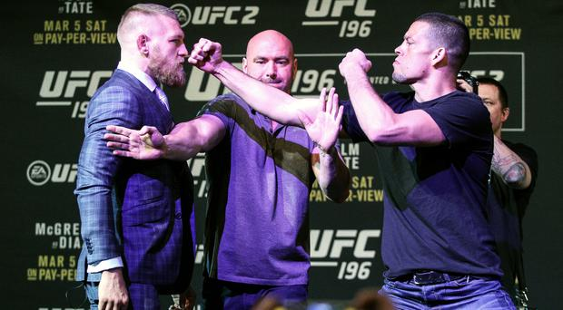 Face off: Conor McGregor (left) and Nate Diaz are kept apart by UFC President Dana White at MGM Grand, Las Vegas yesterday
