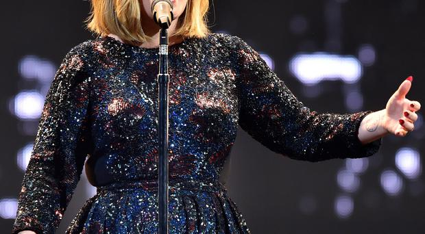 Adele performs on stage at the SSE Arena in Belfast