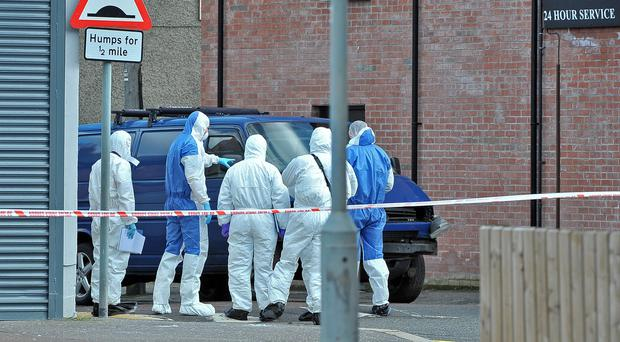 Police forensic experts at the scene where the bomb exploded