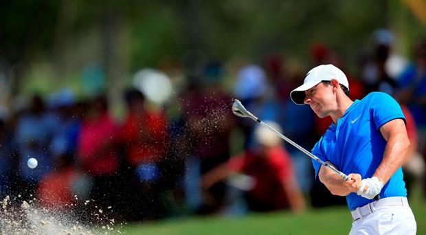 DORAL, FL - MARCH 04: Rory McIlroy of Northern Ireland takes his second shot on the fourth hole during the second round of the World Golf Championships-Cadillac Championship at Trump National Doral Blue Monster Course on March 4, 2016 in Doral, Florida. (Photo by David Cannon/Getty Images)
