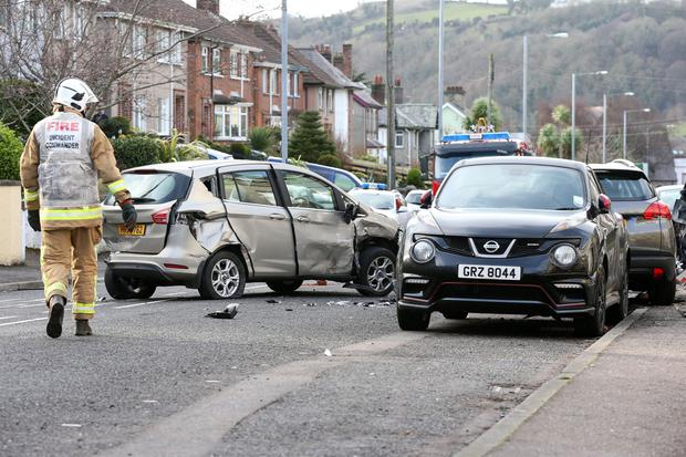 The scene on the Glenarm Road in Larne where a fire engine which had been stolen from the town's fire station during the night crashed into a number of cars and houses. 5 March 16 - Picture by Darren Kidd / Press Eye.