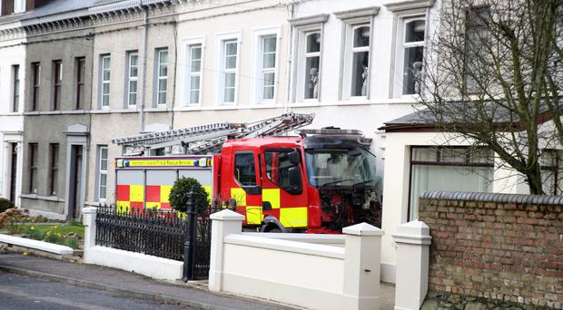 A fire engine that was stolen from a station and driven into nearby cars and houses in Glenarm Road, Larne, Co Antrim. Picture by Darren Kidd / Press Eye