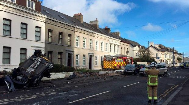 A fire engine that was stolen from a station and driven into nearby cars and houses in Glenarm Road, Larne, Co Antrim. PA