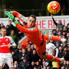 Arsenal's Colombian goalkeeper David Ospina (R) dives but cannot stop the shot from Tottenham Hotspur's English striker Harry Kane (not pictured) as Tottenham score during the English Premier League football match between Tottenham Hotspur and Arsenal at White Hart Lane in London, on March 5, 2016. AFP/Getty Images