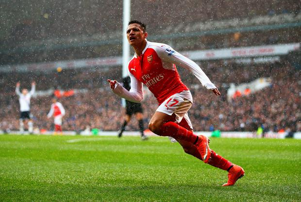 Alexis Sanchez of Arsenal celebrates scoring his team's second goal during the Barclays Premier League match between Tottenham Hotspur and Arsenal at White Hart Lane on March 5, 2016 in London, England. (Photo by Paul Gilham/Getty Images)