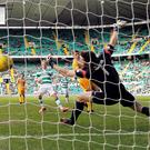 Out of reach: Celtic's Gary Mackay-Steven scores his side's second goal against Morton during the Scottish Cup clash yesterday