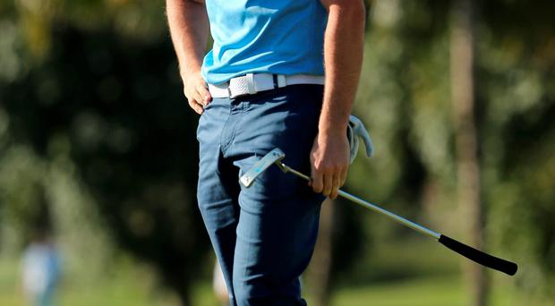 Rory McIlroy reacts to a missed putt on the 10th hole yesterday as his hopes of winning the WGC-Cadillac Championship at Doral fade