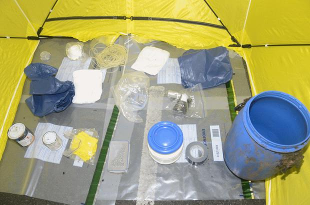 Explosives and bomb making parts found at Carnfunnock Country Park. Explosives are pictured in the round container three in from the right on the front row