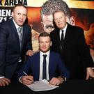 Sign here: James Tennyson agrees to his British title bout with manager Mark Dunlop (left) and promoter Frank Warren (right)