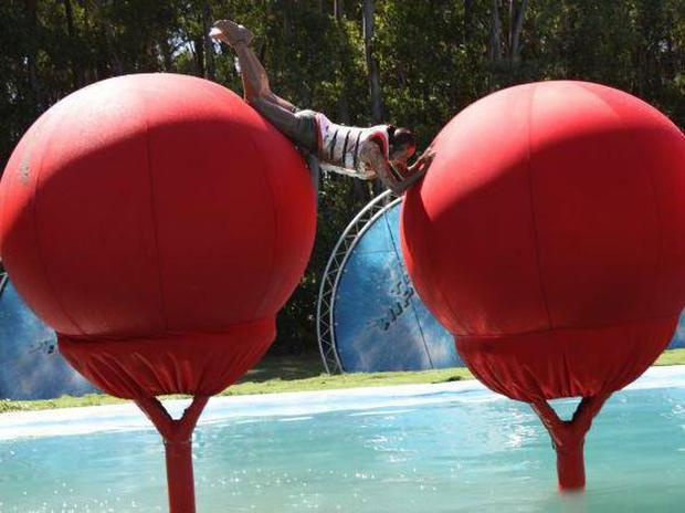 A contestant takes on Total Wipeout's famous Big Red Balls Total Wipeout via Facebook