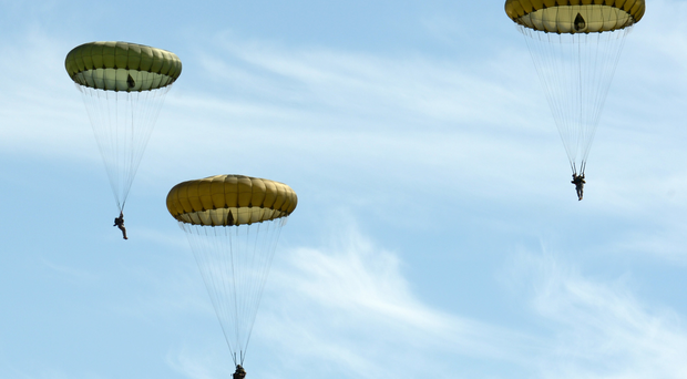 Parachute Regiment soldiers parachute from an aeroplane during an exercise (file photo)
