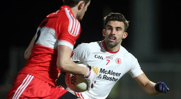 Centre of attention: Tyrone ace Tiernan McCann was blasted for his coming together with Derry's Brendan Rogers