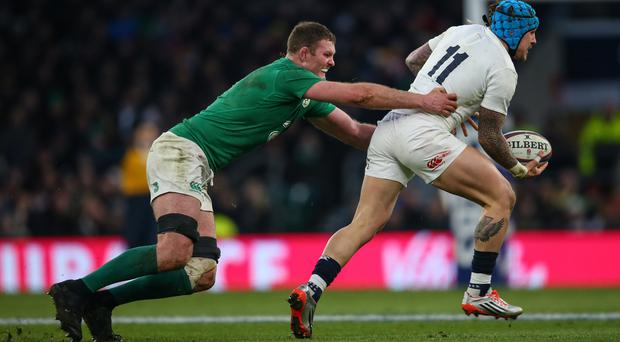 Hang on: Donnacha Ryan puts in a strong challenge on Jack Nowell at Twickenham