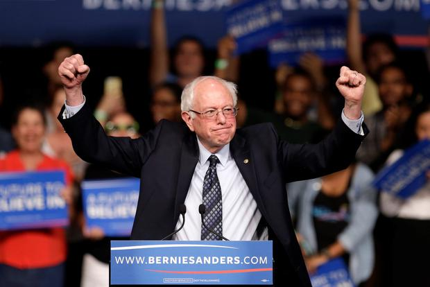 Democratic presidential candidate, Sen. Bernie Sanders, I-Vt. acknowledges his supporters on arrival at a campaign rally, Tuesday, March 8, 2016, in Miami. (AP Photo/Alan Diaz)