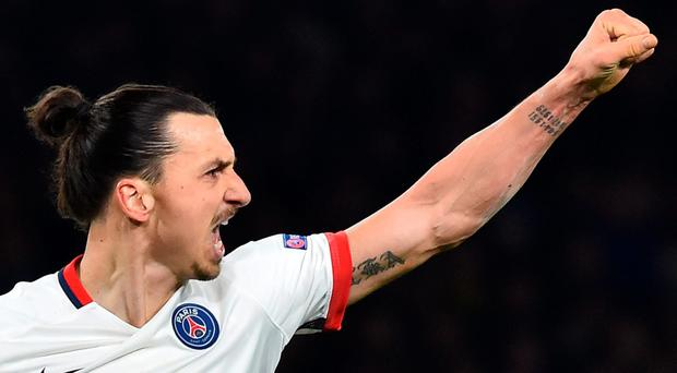 Paris Saint-Germain's Swedish forward Zlatan Ibrahimovic celebrates scoring his team's second goal during the UEFA Champions League round of 16 second leg football match between Chelsea and Paris Saint-Germain (PSG) at Stamford Bridge in London on March 9, 2016. AFP/Getty Images