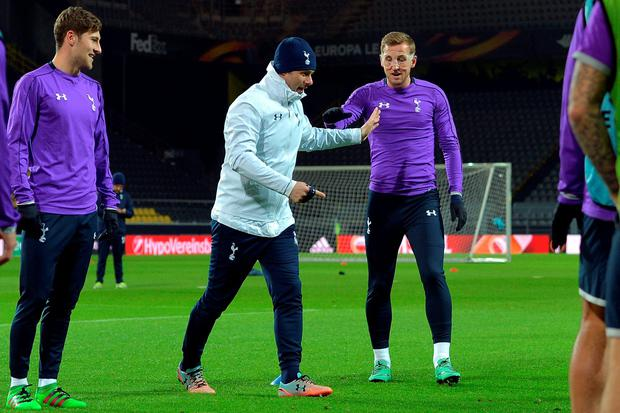 Showing the way: Mauricio Pochettino takes Harry Kane through his paces as they gear up for the Dortmund clash