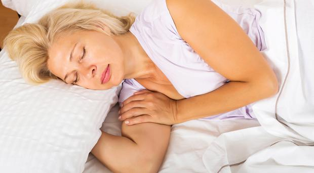 Sweet dreams: The menopause can affect women's sleep. Picture posed by model