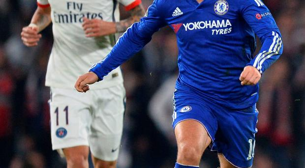 Fashion faux pas: Eden Hazard was slammed for swapping tops at half-time with PSG's Angel Di Maria (left)