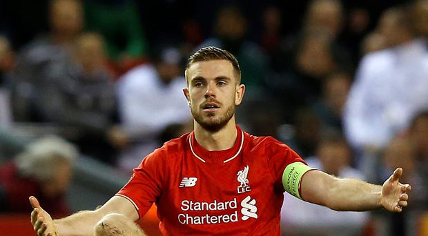 Cautious: Jordan Henderson says Liverpool still have work to do