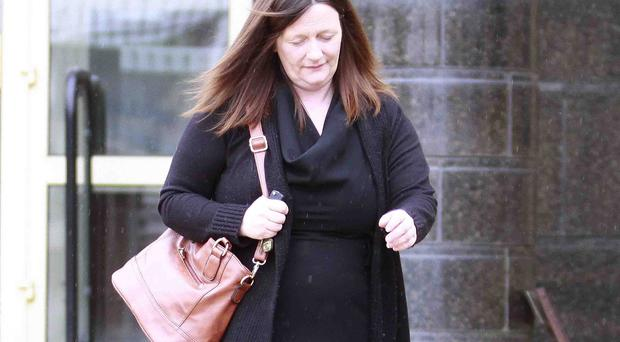 Nicola Currell from Glenarm, who is alleged to have committed fraud while working as a senior wedding planner at Glengorm Resort and Spa, leaves Antrim Crown Court on Friday where she pleaded not guilty to all charges. Picture Mark Jamieson