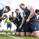 In the thick of it: Rory Best (centre) and his Ireland team-mates work on their scrum ahead of the clash against Italy