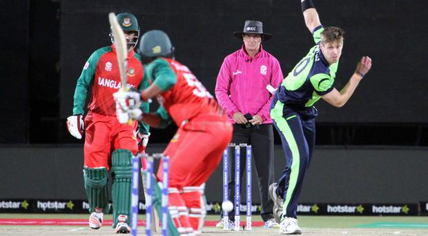 Over and out: Boyd Rankin leads the Ireland attack against Bangladesh in Dharamsala yesterday but his side are out of World Twenty20