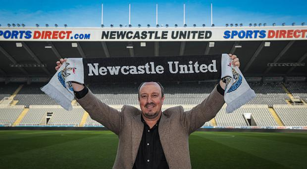 Looking ahead: Rafael Benitez checks out his new surroundings after succeeding Steve McClaren as Newcastle manager