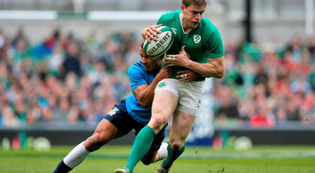 Italy's David Odiete (left) tackles Ireland's Andrew Trimble during the 2016 RBS 6 Nations match at the Aviva Stadium, Dublin.