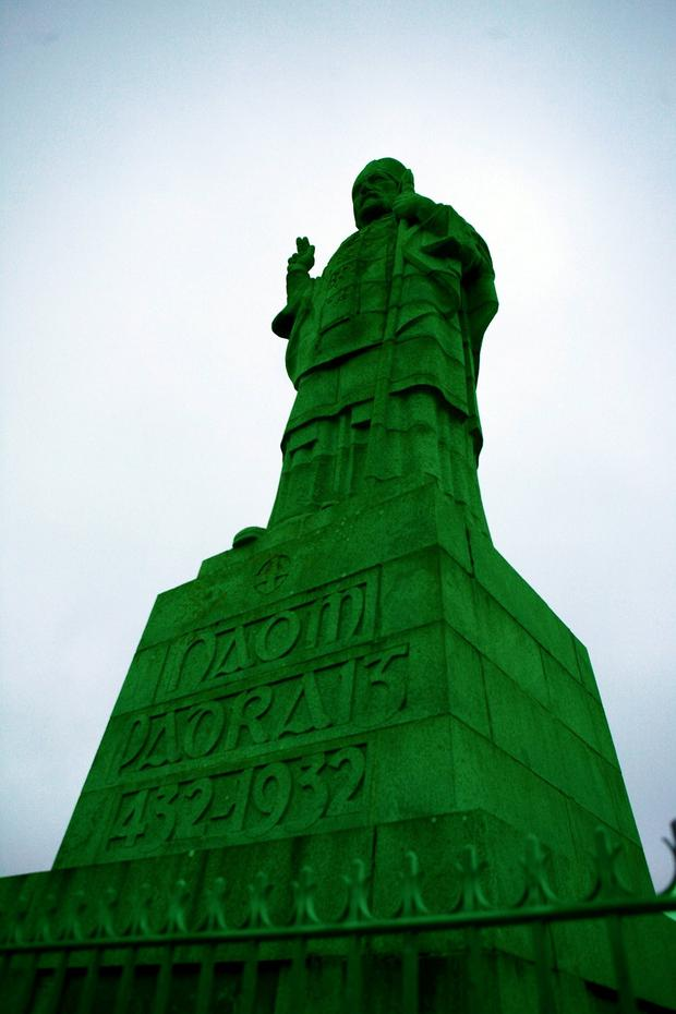 Statue of Saint Patrick on Slieve Patrick goes green for St Patrick CREDIT: Brendan Black