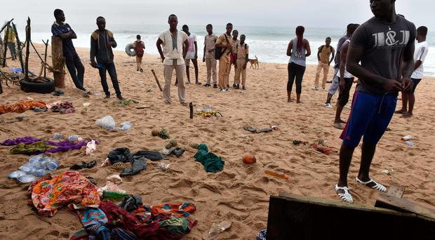 Residents gather on the beach on March 14 , 2016 in Grand Bassam a day after heavily armed gunmen opened fire at a hotel in the Ivory Coast beach resort of Grand-Bassam. Gunmen killed 16 people at an Ivory Coast resort on March 13 leaving bodies strewn on the beach, in an attack claimed by an Al-Qaeda affiliate as fears grow of a mounting jihadist threat in west Africa. Armed with grenades and assault riffles, the attackers stormed three hotels in the sleepy resort of Grand-Bassam, popular with expats, around 40 kilometres (25 miles) east of the commercial hub Abidjan. / AFP PHOTO / ISSOUF SANOGOISSOUF SANOGO/AFP/Getty Images