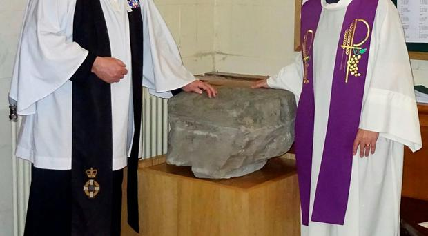Undated handout photo issued by ken Johnston of Padre Andrew Totten (left) and the Dean of Down Cathedral The Very Reverent Henry Hull (right) as an ancient religious stone closely linked with Saint Patrick has been presented to Down Cathedral by the Army. PA
