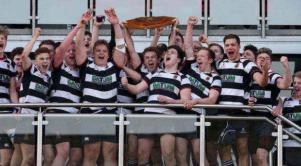 Wallace High School captain Jonny Stewart lifts the Subsidiary Shield after a 21-5 victory over Down High School during Monday's Danske Bank Subsidiary Shield Final at Kingspan Stadium. Picture by Brian Little/Presseye