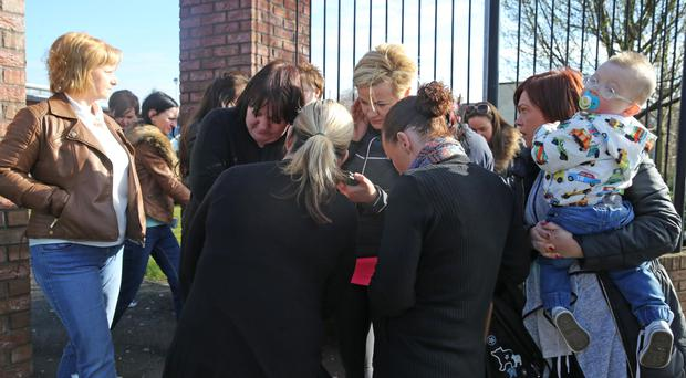 About 20 parents of pupils at De La Salle College in west Belfast have met to express their concerns about ongoing incidents at the school.They gathered at the Andersonstown school's entrance on Tuesday morning. Pic Pacemaker.
