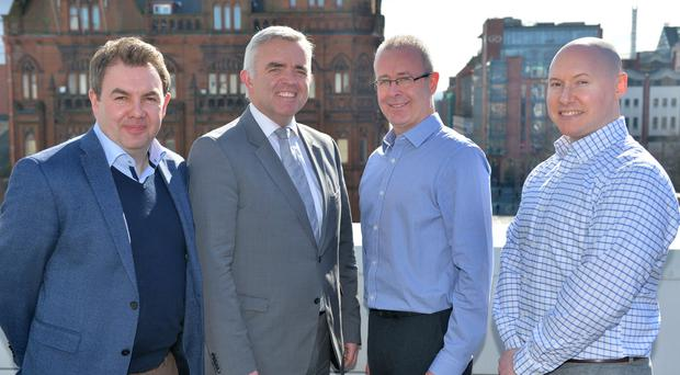 Pictured with the Minister Jonathan Bell are John Barron, Sales and Marketing Director, Eamonn Murray, Programme Manager and Ivan Mc Shane, Engineering Director of Vennetics