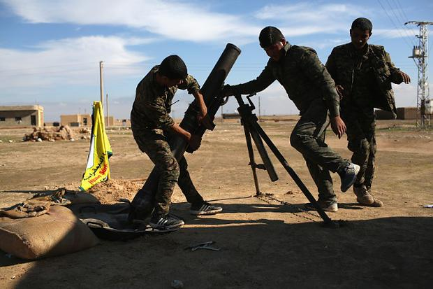Troops from the Syrian Democratic Forces prepare to fire mortars on ISIL positions on the frontline on November 11, 2015 near Hasaka, in the autonomous region of Rojava, Syria. (Photo by John Moore/Getty Images)
