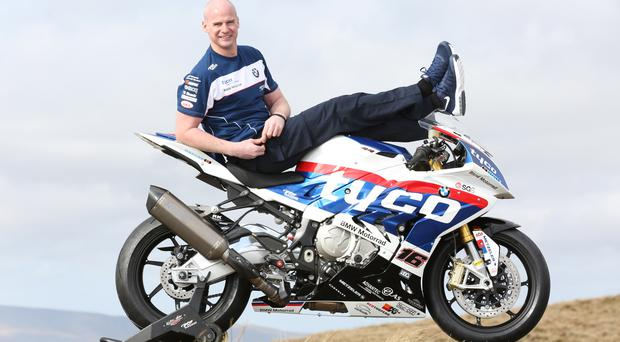 Laid-back: Ryan Farquhar poses with his Tyco BMW Superbike, which he will campaign at the Isle of Man TT
