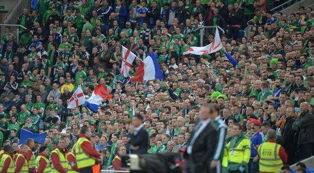 Happier times: Northern Ireland fans with French flags at Windsor Park