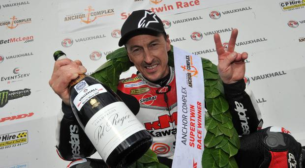 Bubbly character: Jeremy McWilliams celebrates victory at North West last May