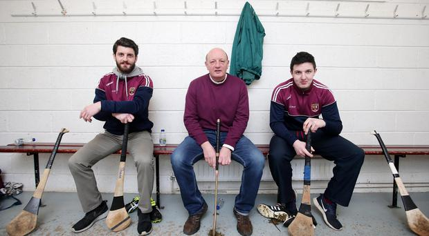 Three of a kind: Terence 'Sambo' McNaughton (centre) and sons Shane (left) and Christy (right) are determined to lead Ruairi Óg, Cushendall to All-Ireland glory at Croke Park
