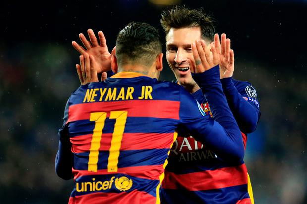 Barcelona's Brazilian forward Neymar (L) celebrates a goal with Barcelona's Argentinian forward Lionel Messi during the UEFA Champions League Round of 16 second leg football match FC Barcelona vs Arsenal FC at the Camp Nou stadium in Barcelona on March 16, 2016. AFP/Getty Images