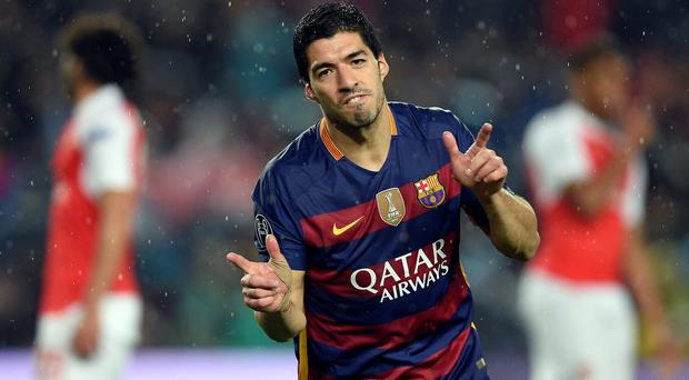 Barcelona's Uruguayan forward Luis Suarez celebrates a goal during the UEFA Champions League Round of 16 second leg football match FC Barcelona vs Arsenal FC at the Camp Nou stadium in Barcelona on March 16, 2016. / AFP PHOTO / LLUIS GENELLUIS GENE/AFP/Getty Images
