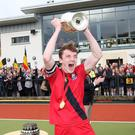 Final flourish: Banbridge Academy captain Andrew Bennington lifts the Burney Cup