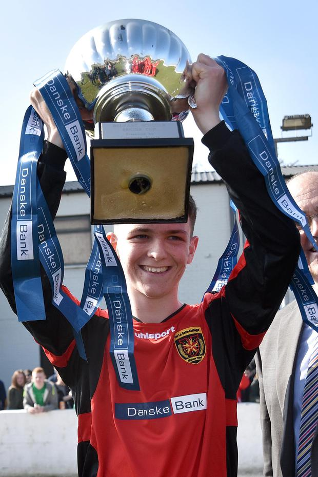 De La Salle captain, Niall McParland proudly hoists the trophy aloft after his team's 3-1 victory over St Malachy's college. Tony Hendron Presseye.