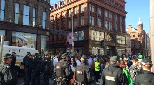 Police maintain a heavy presence as large crowds gather in Belfast City Centre.