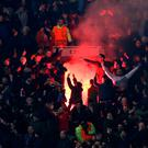 Liverpool fans let off a red flare in the stands during the UEFA Europa League match at Old Trafford, Manchester. PRESS ASSOCIATION Photo. Picture date: Thursday March 17, 2016. See PA story SOCCER Man Utd. Photo credit should read: Martin Rickett/PA Wire