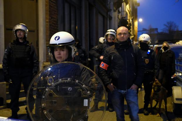 Belgian police forces stand guard in a street during a police action in the Molenbeek-Saint-Jean district in Brussels, on March 18, 2016. A police operation was underway on March 18, in the Brussels area home to key Paris attacks suspect Salah Abdeslam whose fingerprints were found in an apartment raided this week, the federal prosecutor's office said. AFP PHOTO / JOHN THYSJOHN THYS/AFP/Getty Images
