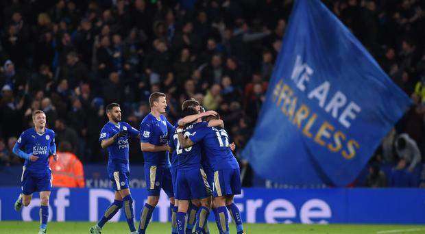 Leicester top the Premier League by five points